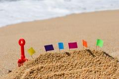 Château de sable à la plage Photos libres de droits