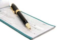 Chèque avec le crayon lecteur image stock