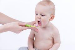 Chéri avec la brosse à dents Photos stock