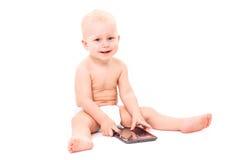 Chéri avec la tablette digitale Images stock