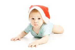 Chéri avec le chapeau rouge de Noël Photos stock