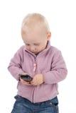 Chéri avec un téléphone portable Photographie stock libre de droits