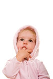Chéri dans le doigt rose dans la bouche recherchant Photo stock