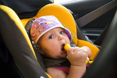 Chéri dans le siège de véhicule Photographie stock libre de droits