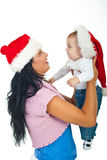 Chéri de fixation de mère à premier Noël Photos stock