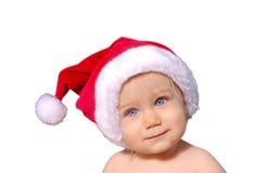 Chéri mignonne dans le chapeau de Santa Photographie stock