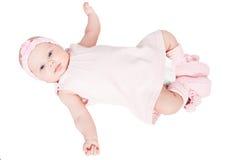 Chéri nouveau-née dans la robe rose Image stock