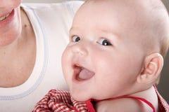 Chéri nouveau-née de sourire Photographie stock