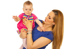 Chéri pleurante de fixation de mère Image libre de droits