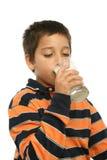 chłopak pije mleko szkła obraz royalty free