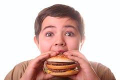 chłopiec łasowania hamburgeru potomstwa Obrazy Stock