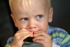 Chłopiec łasowania melon Obrazy Stock