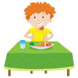 Chłopiec łasowanie na stole royalty ilustracja
