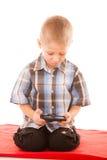 Chłopiec bawić się gry na smartphone Obraz Stock
