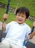 chłopiec bawić się huśtawkę Zdjęcia Stock