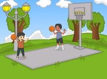 Chłopiec bawić się koszykówkę przy parkową kreskówką Obrazy Stock