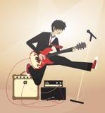 Chłopiec bawić się na gitarze elektrycznej i doskakiwaniu Zdjęcie Royalty Free