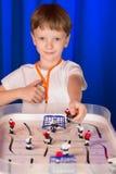 Chłopiec bawić się stołowego hokeja Obraz Royalty Free