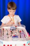 Chłopiec bawić się stołowego hokeja Obrazy Royalty Free