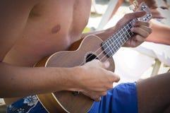 Chłopiec bawić się ukulele Zdjęcia Stock
