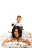 Chłopiec bawić się z jego matką Zdjęcia Royalty Free