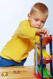 Chłopiec bawić się z samochodami Obrazy Royalty Free