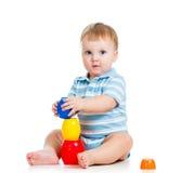 Chłopiec bawić się z zabawkami Zdjęcia Royalty Free