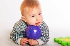 chłopiec bawić się zabawki Zdjęcia Stock