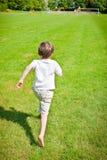 Chłopiec bieg Zdjęcia Stock