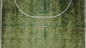 Chłopiec bieg z piłki nożnej piłką bramy zbiory