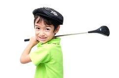 Chłopiec bierze kija golfowego fotografia stock