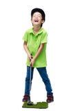 Chłopiec bierze kija golfowego zdjęcie royalty free