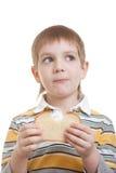 chłopiec chleba kawałka pozycja Fotografia Stock