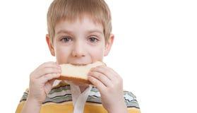 chłopiec chleba kawałka pozycja Obraz Stock