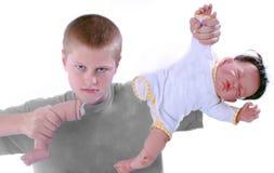 Chłopiec ciągnięcia noga z dziecka - lala obraz stock