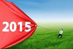 Chłopiec ciągnięcie liczba 2015 dla postępu Fotografia Royalty Free