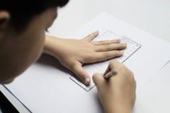 Chłopiec ciekawie robi pracie domowej obraz royalty free