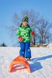 Chłopiec cieszy się sanie przejażdżkę Zdjęcie Royalty Free