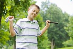 chłopiec clug ufni golfowi szczęśliwi mienia potomstwa Zdjęcia Stock