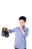 Chłopiec czuć nieszczęśliwy z złego odoru bielu skarpetą Zdjęcia Stock