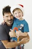 Chłopiec dalej i jego dziad z Bożenarodzeniowym cukierkiem Zdjęcia Royalty Free