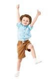 Chłopiec doskakiwanie i mieć zabawa odizolowywająca na białym tle Zdjęcia Royalty Free
