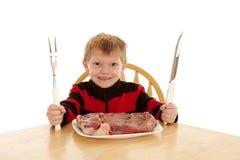 Chłopiec duży stek obraz royalty free