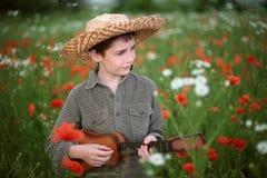 chłopiec gitary bawić się zdjęcie royalty free