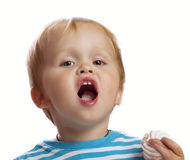 Chłopiec je cukierki Fotografia Stock
