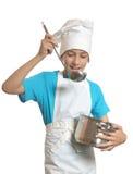 Chłopiec jest ubranym szefa kuchni mundur Zdjęcie Royalty Free