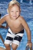 Chłopiec jest w pływackim basenie Obrazy Stock
