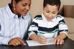 chłopiec kobiety writing Fotografia Royalty Free