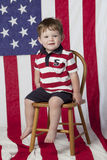 chłopiec krzesła flaga trochę Obrazy Royalty Free