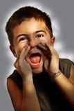 chłopiec krzyki zdjęcia stock
